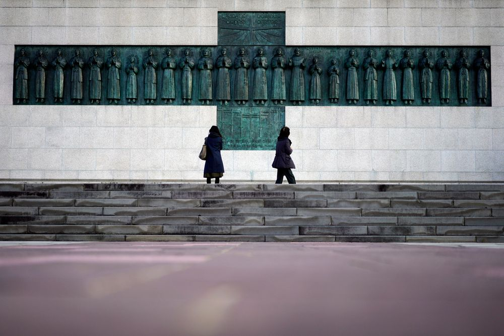 In this Nov. 17, 2019, photo, people visit the Twenty-Six Martyrs Monument in Nagasaki, southern Japan. Pope Francis will start his first official visit to Japan in Nagasaki, ground zero for the Christian experience in a nation where the Catholic leader once dreamed of living as a missionary. (AP Photo/Eugene Hoshiko)