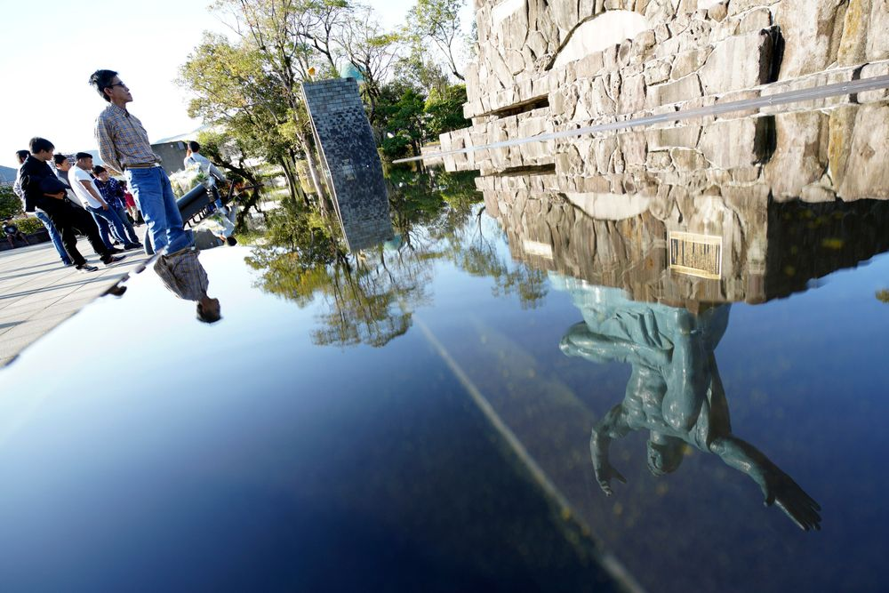 In this Nov. 16, 2019, photo, the Statue of Peace is reflected on water fountain at the Peace Park in Nagasaki, southern Japan. Pope Francis will start his first official visit to Japan in Nagasaki, ground zero for the Christian experience in a nation where the Catholic leader once dreamed of living as a missionary. (AP Photo/Eugene Hoshiko)