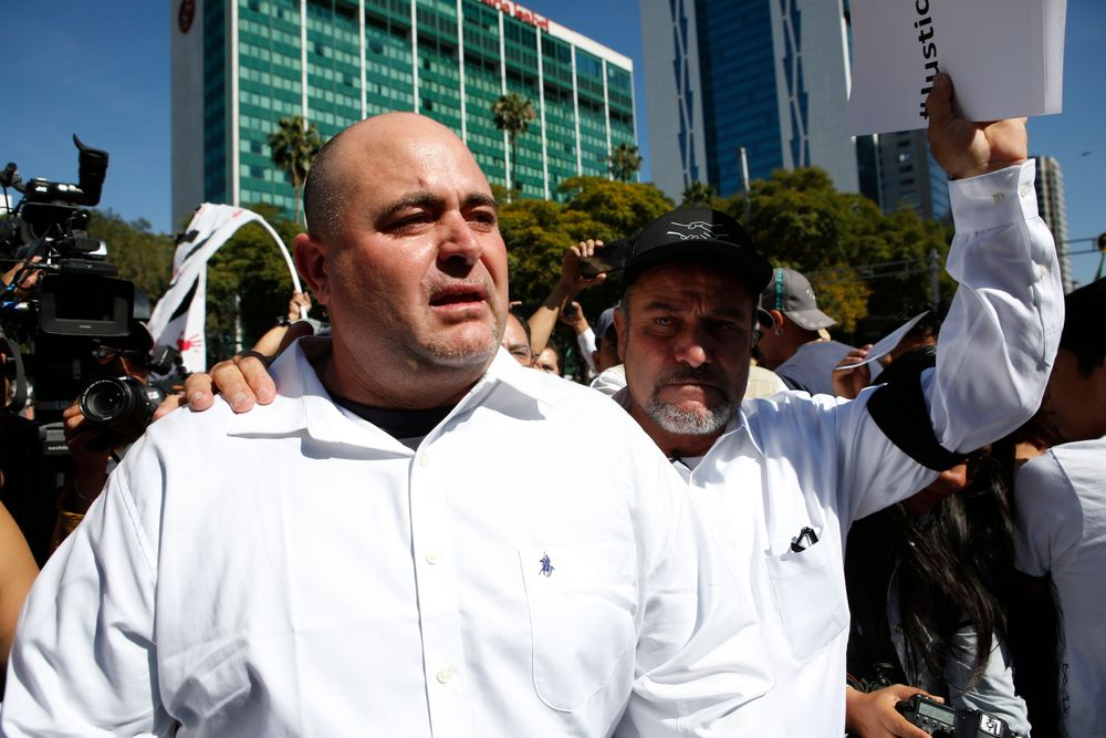 Julian LeBaron, left, walks with Adrian LeBaron before a protest against the first year in office of Mexico's President Andres Manuel Lopez Obrador, in Mexico City, Sunday, Dec. 1, 2019. The men joined a protest on Mexico City's Reforma avenue to expressed anger and frustration over increasingly appalling incidents of violence, a stagnant economy and deepening political divisions in the country. (AP Photo/Ginnette Riquelme)
