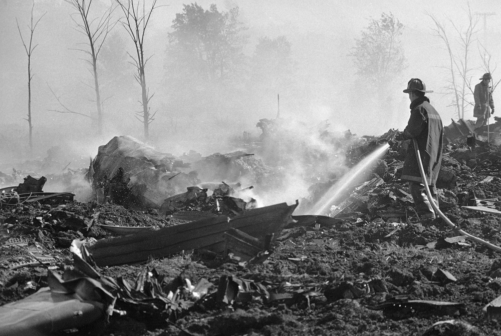 FILE - In this May 25, 1979 file photo, a fireman hoses down twisted remains of an American Airlines DC-10 which crashed and exploded on takeoff from O'Hare International Airport, in Chicago. Decades later, the crash of American Airlines Flight 191 moments after it took off from Chicago's O'Hare International Airport remains the deadliest aviation accident in U.S. history. The DC-10 was destined for Los Angeles when it lost one of its engines killing what investigators later determined were 273 people _ all 271 people aboard the jetliner and two people on the ground. (AP Photo/Fred Jewell File)