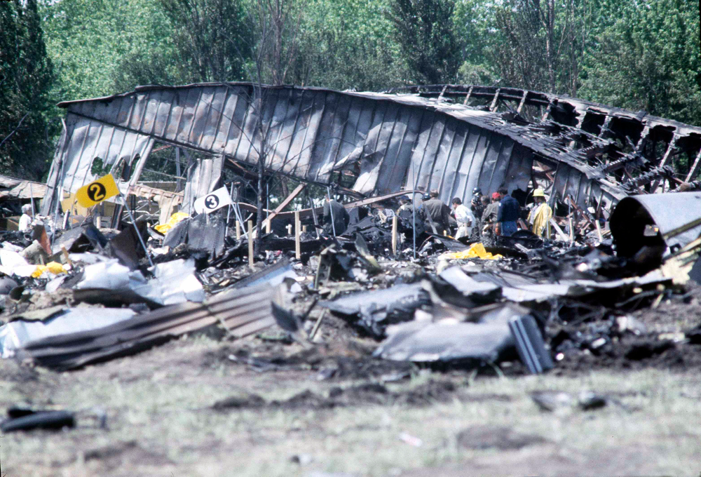 FILE - In this May 26, 1979 file photo, investigators view the wreckage of the ill-fated American Airlines Flight 191 to Los Angeles, which crashed on take off in Chicago. Decades later, the crash, moments after it took off from Chicago's O'Hare International Airport, remains the deadliest aviation accident in U.S. history. The DC-10 was destined for Los Angeles when it lost one of its engines May 25, 1979, killing what investigators later determined were 273 people _ all 271 people aboard the jetliner and two people on the ground. (AP Photo/Fred Jewell File)