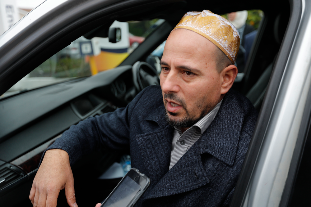 """Gamal Fouda, the imam of Al Noor mosque, speaks after a special blessing ceremony near the site of Friday's shooting outside the Linwood Mosque in Christchurch, New Zealand, Monday, March 18, 2019. On Friday, Fouda had just finished the Khutbah, the formal sermon that's delivered in Arabic, and he had started the next part in which he translated it into English. As the gunman approached the mosque, a man in the entrance called out cheerfully, """"Hello, brother."""" Brenton Tarrant fired several shots, one after another, and walked past the first bodies. (AP Photo/Vincent Thian)"""