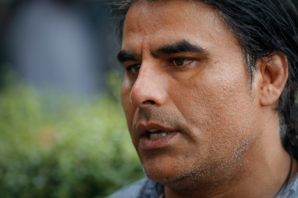 FILE - In this March 16, 2019, file photo, Abdul Aziz, survivor of mosque shooting speaks to Associated Press during an interview in Christchurch, New Zealand. Aziz is being hailed as a hero for preventing more deaths during Friday prayers at the Linwood mosque in Christchurch. (AP Photo/Vincent Thian, File)