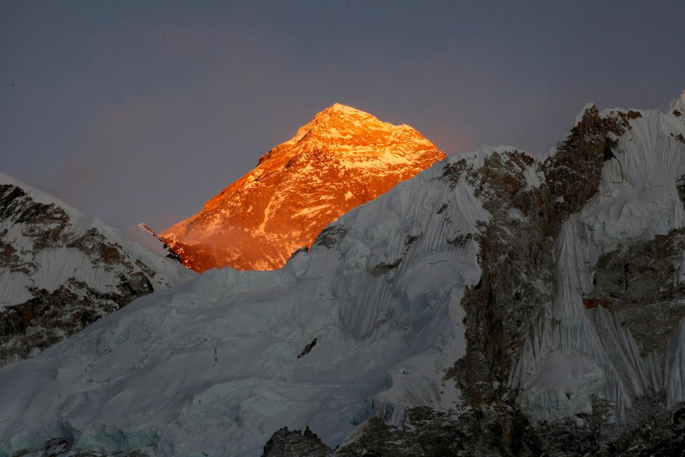 FILE - In this Nov. 12, 2015, file photo, Mt. Everest is seen from the way to Kalapatthar in Nepal. Nepal mountaineering authorities have determined that an Indian couple faked a Mount Everest ascent earlier this year by altering photographs to show they were on the summit. A Nepalese national has shattered the previous mountaineering record for successfully climbing the world's 14 highest peaks, completing the feat in 189 days. (AP Photo/Tashi Sherpa, File)