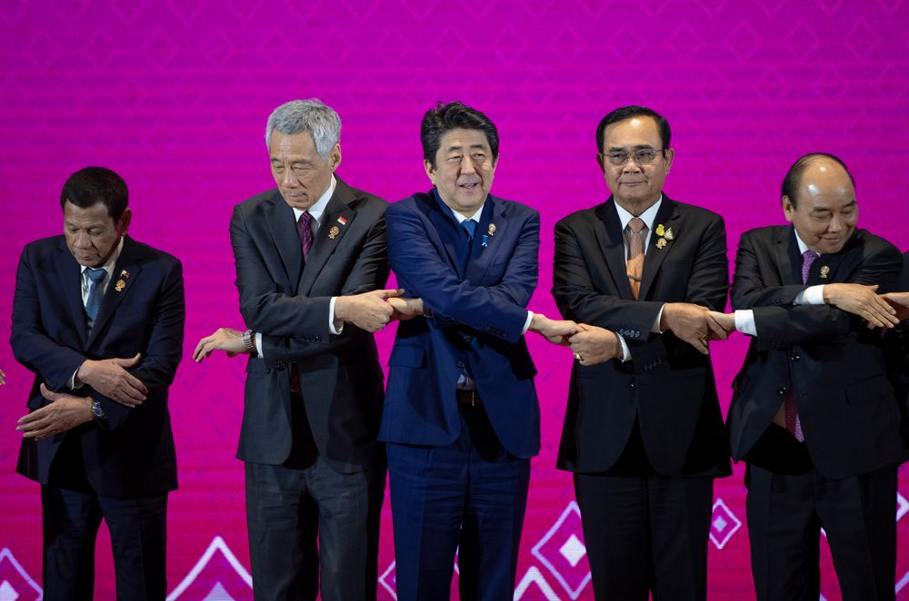 Japan Prime Minister Shinzo Abe, center, poses for a group photo with leaders of ASEAN, from left; Philippines President Rodrigo Duterte, Singapore Prime Minister Lee Hsien Loong, Thailand Prime Minister Prayuth Chan-ocha, and Vietnam Prime Minister Nguyen Xuan Phuc during ASEAN-Japan summit in Nonthaburi, Thailand, Monday, Nov. 4, 2019. (AP Photo/Gemunu Amarasinghe )
