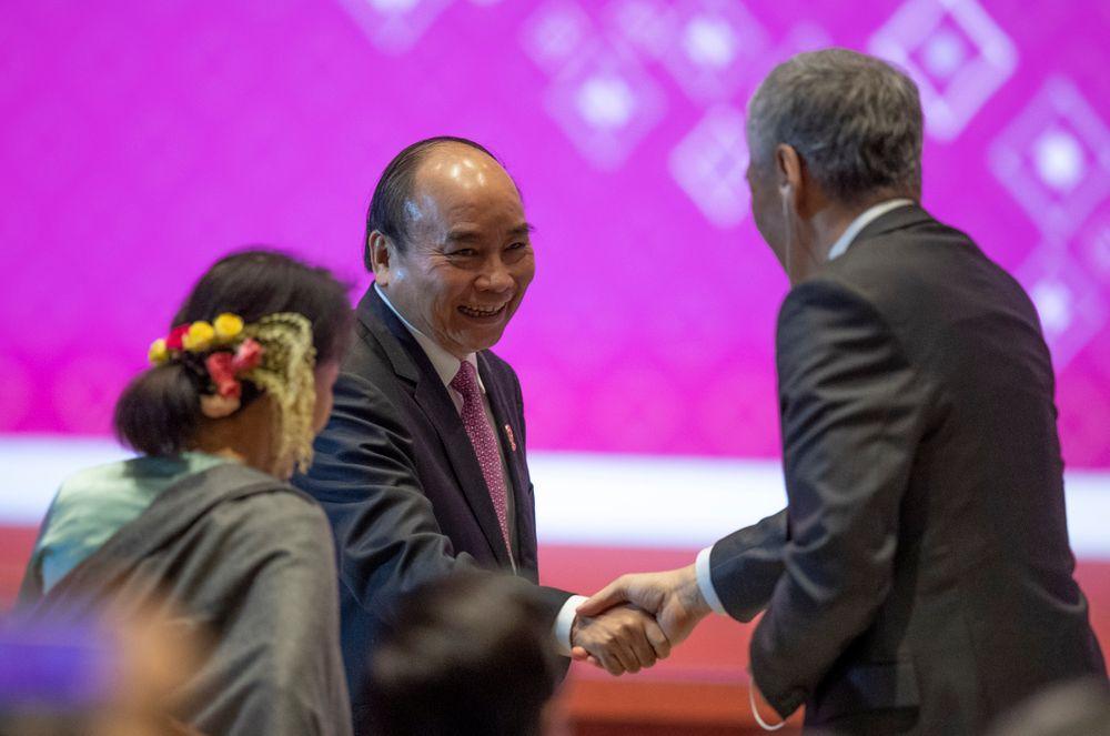 Vietnam Prime Minister Nguyen Xuan Phuc shakes hands during the closing ceremony of ASEAN summit in Nonthaburi, Thailand, Monday, Nov. 4, 2019. (AP Photo/Gemunu Amarasinghe)