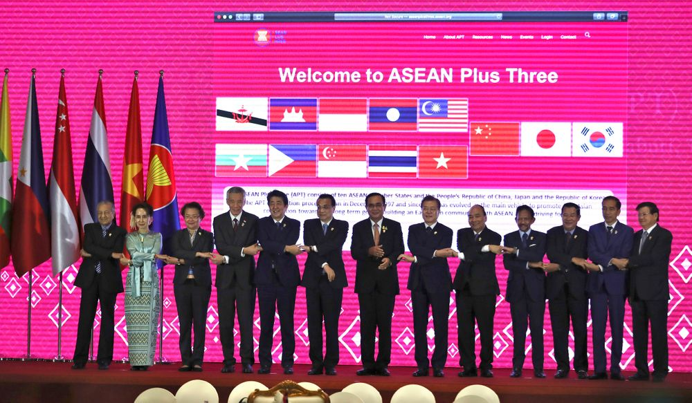 From left, Malaysian Prime Minister Mahathir Mohamad, Myanmar leader Aung San Suu Kyi, Philippines Foreign Affairs Assistant Secretary for ASEAN Affairs Junever Mahilum-West, Singapore's Prime Minister Lee Hsien Loong, Japanese Prime Minister Shinzo Abe, Chinese Premier Li Keqiang, Thailand Prime Minister Prayuth Chan-ocha, South Korean President Moon Jae-in, Vietnam Prime Minister Nguyen Xuan Phuc, Brunei Sultan Hassanal Bolkiah, Cambodia Prime Minister Hun Sen, Indonesia President Joko Widodo and Laos Prime Minister Thongloun Sisoulith pose for a group photo at the Association of Southeast Asian Nations (ASEAN) Plus Three summit in Nonthaburi, Thailand, Monday, Nov. 4, 2019. (AP Photo/Aijaz Rahi)