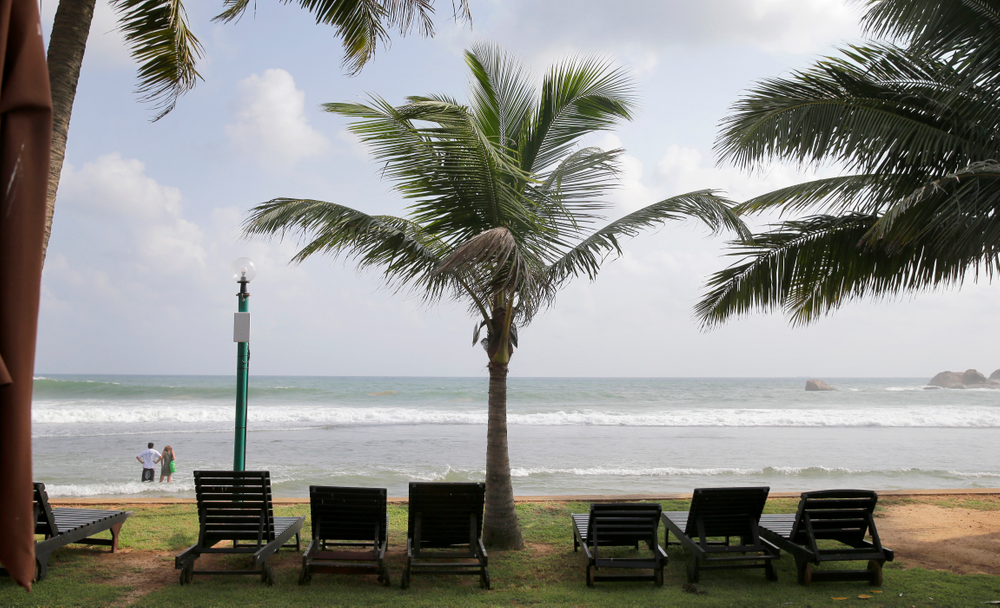 In this Friday, May 10, 2019, photo, lounge chairs lie on a deserted beach in Hikkaduwa, Sri Lanka. Sri Lanka was the Lonely Planet guide's top travel destination for 2019, but since the Easter Sunday attacks on churches and luxury hotels, foreign tourists have fled. Hikkaduwa, in the south west, used to be top tourist attraction for the strong waves that were perfect for board-surfing and sparkling clear waters perfect for snorkeling. Today, of the 27 hotels, a very few are still open while most of others along with the eateries lining the six kilometer stretch of palm-fringed beach, are closed. (AP Photo/Eranga Jayawardena)