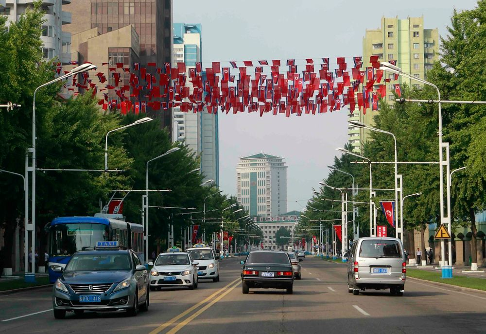 Chinese and North Korean national flags hang over a street in Pyongyang, North Korea, Friday, June 21, 2019. Chinese President Xi Jinping offered encouragement for North Korea's focus on economic development in a speech in Pyongyang, turning to a topic Beijing has long pressed with its communist neighbor amid wider concerns over the North's nuclear weapons program. (AP Photo/Cha Song Ho)
