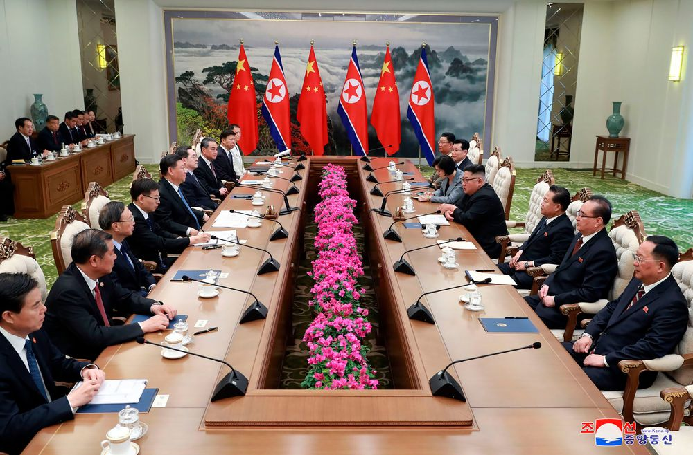 In this Thursday, June 20, 2019, photo provided by the North Korean government, North Korean leader Kim Jong Un, fourth right, and Chinese President Xi Jinping, fifth left, meet at Kumsusan guest house in Pyongyang, North Korea. The content of this image is as provided and cannot be independently verified. Korean language watermark on image as provided by source reads: