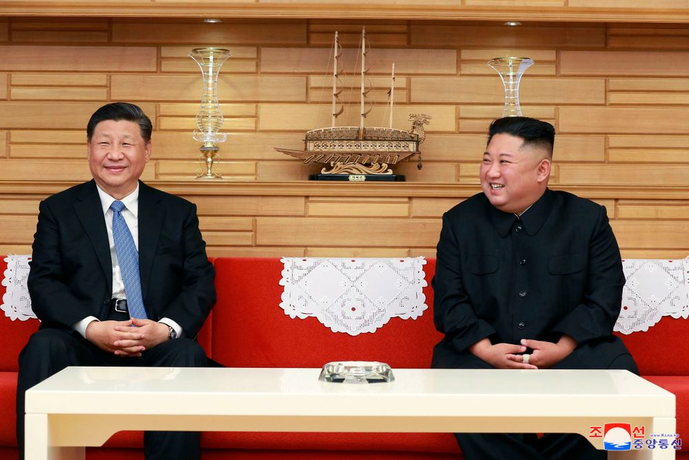 In this Thursday, June 20, 2019, photo provided by the North Korean government, North Korean leader Kim Jong Un, right, and Chinese President Xi Jinping meet at Kumsusan guest house in Pyongyang, North Korea. The content of this image is as provided and cannot be independently verified. Korean language watermark on image as provided by source reads: