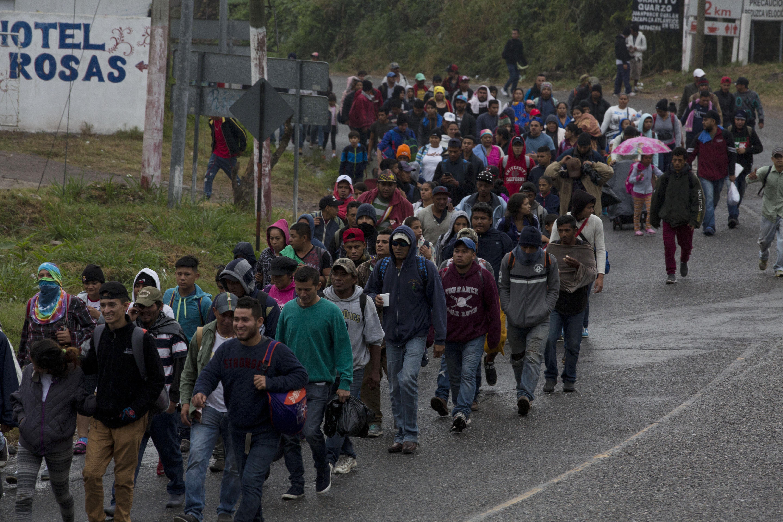 Honduran migrants walk along the roadside through Esquipulas, Guatemala, as they make their way toward the U.S. border, early Wednesday, Jan. 16, 2019. The latest caravan of Honduran migrants hoping to reach the U.S. has crossed into Guatemala. (AP Photo/Moises Castillo)