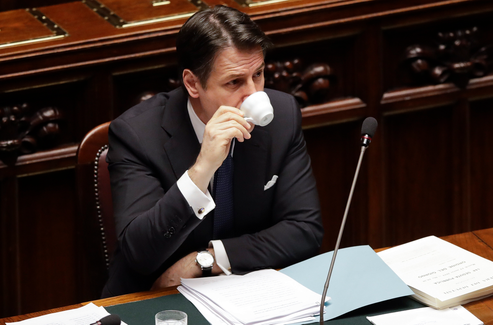 Italian Premier Giuseppe Conte drinks a coffee before addressing the Lower Chamber of the Italian parliament in Rome, Tuesday, March 19, 2019. (AP Photo/Alessandra Tarantino)