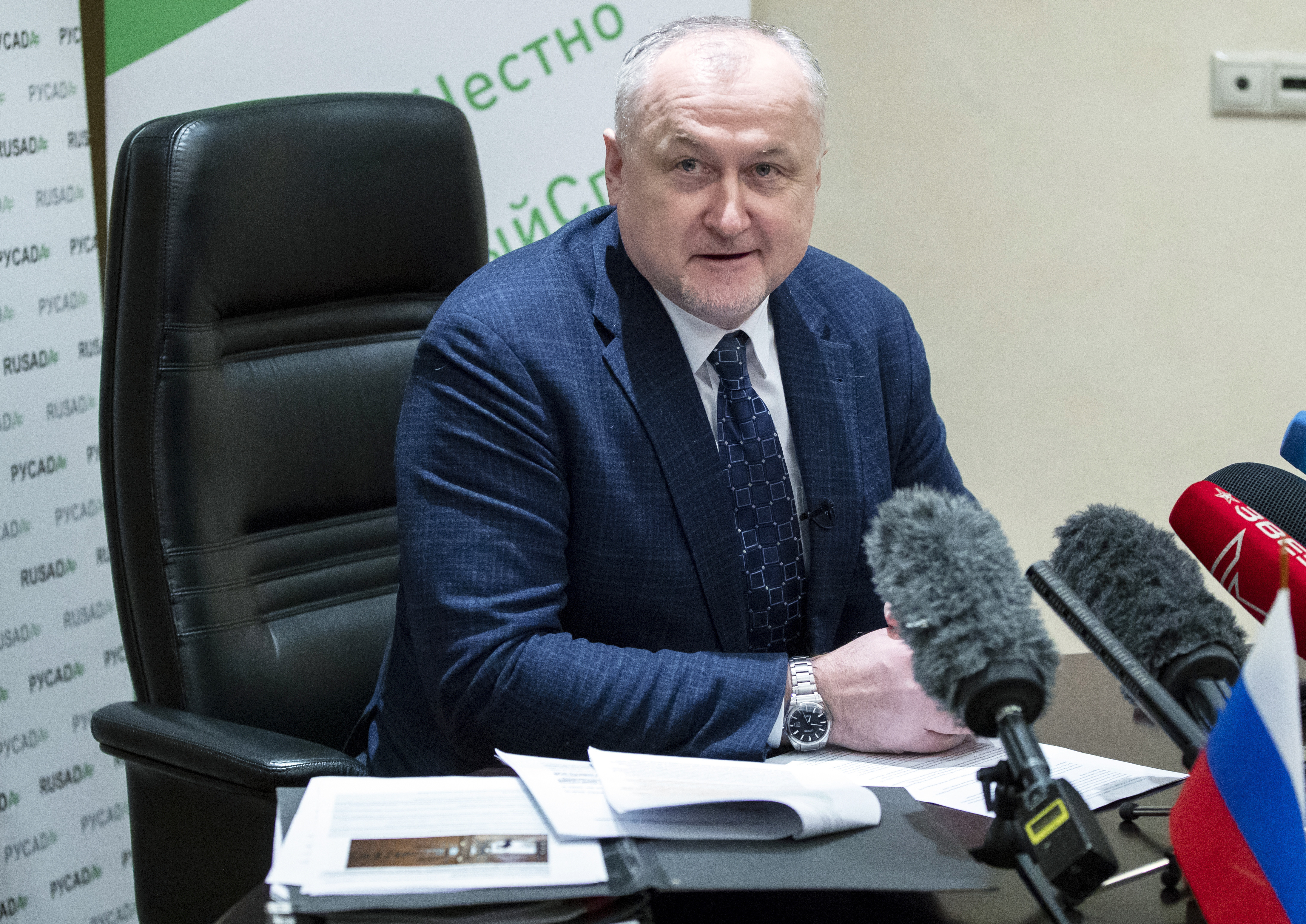 Russian National Anti-doping Agency RUSADA head Yuri Ganus smiles during a news conference in Moscow, Russia, Tuesday, Jan. 22, 2019.  World Anti-Doping Agency (WADA) forgave Russia on Tuesday for its tardiness in turning over lab data, but they are still analyzing what it says are vast amounts of data from lab servers and equipment, data which until recently was sealed off by Russian law enforcement. (AP Photo/Pavel Golovkin)