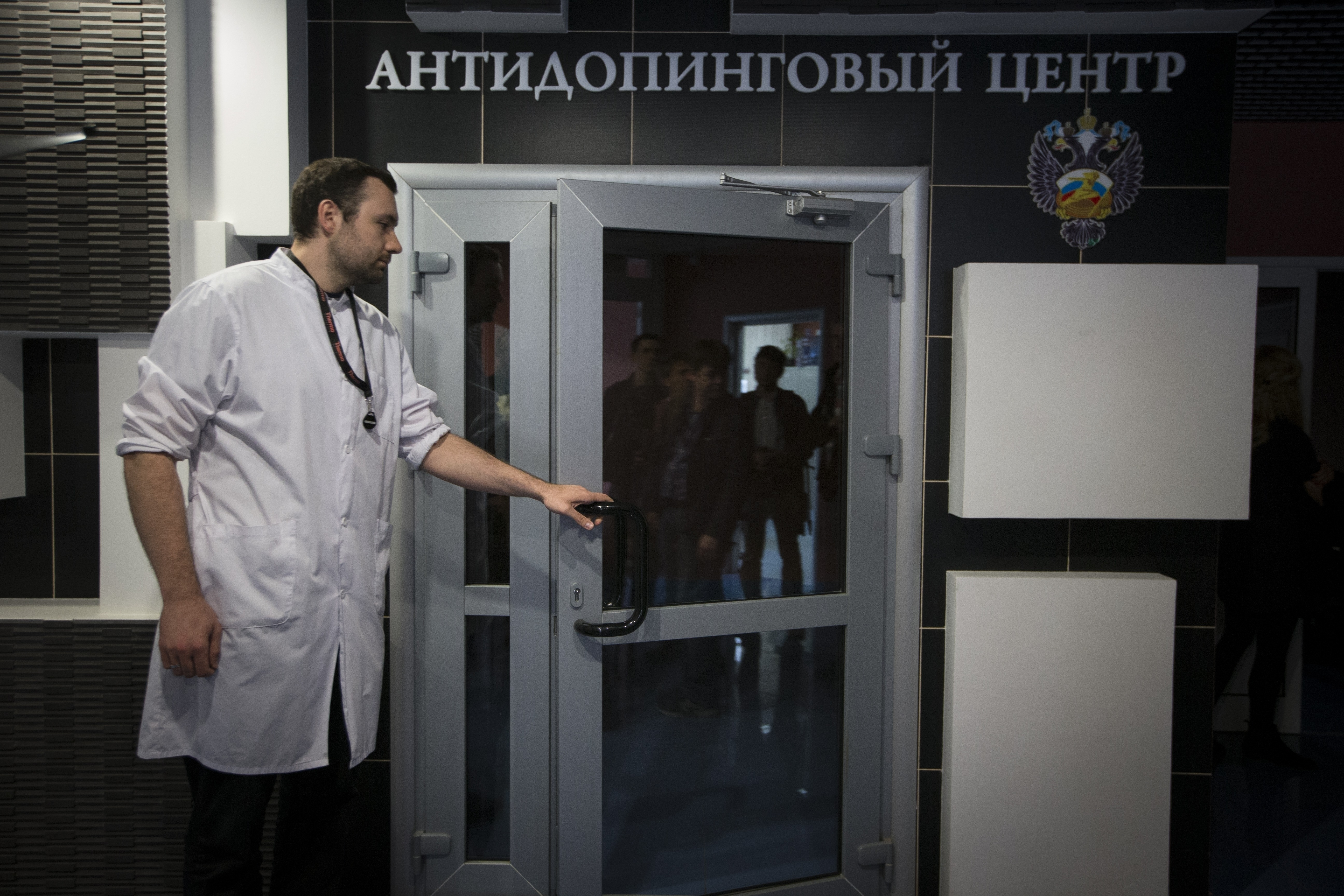 FILE - In this Tuesday, May 24, 2016 file photo, Grigory Dudko opens a door for journalists during a visit to Russia's national drug-testing laboratory in Moscow, Russia. Vladimir Putin's spokesman says Russia is