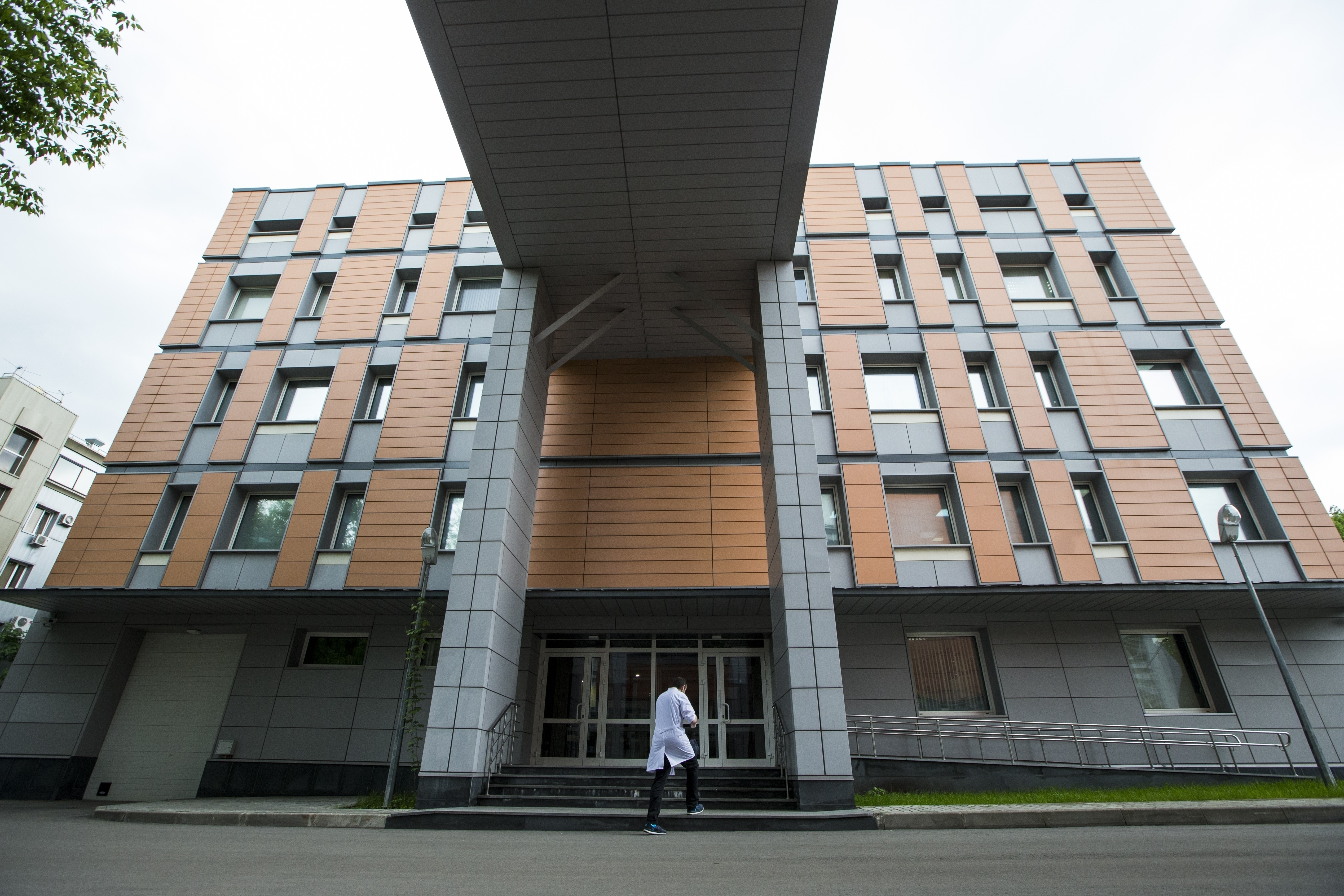 FILE - In this Tuesday, May 24, 2016 file photo, an employee walks into the building of the Russia's national drug-testing laboratory in Moscow, Russia. Vladimir Putin's spokesman says Russia is