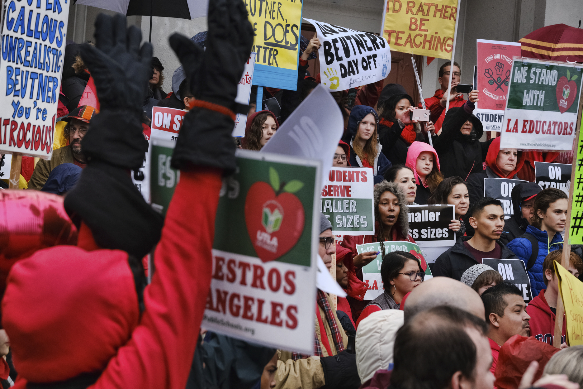 Teachers and students rally in the steps in front of Hamilton High School, Wednesday, Jan. 16, 2019, in Los Angeles, during a citywide teacher strike. (AP Photo/Richard Vogel)