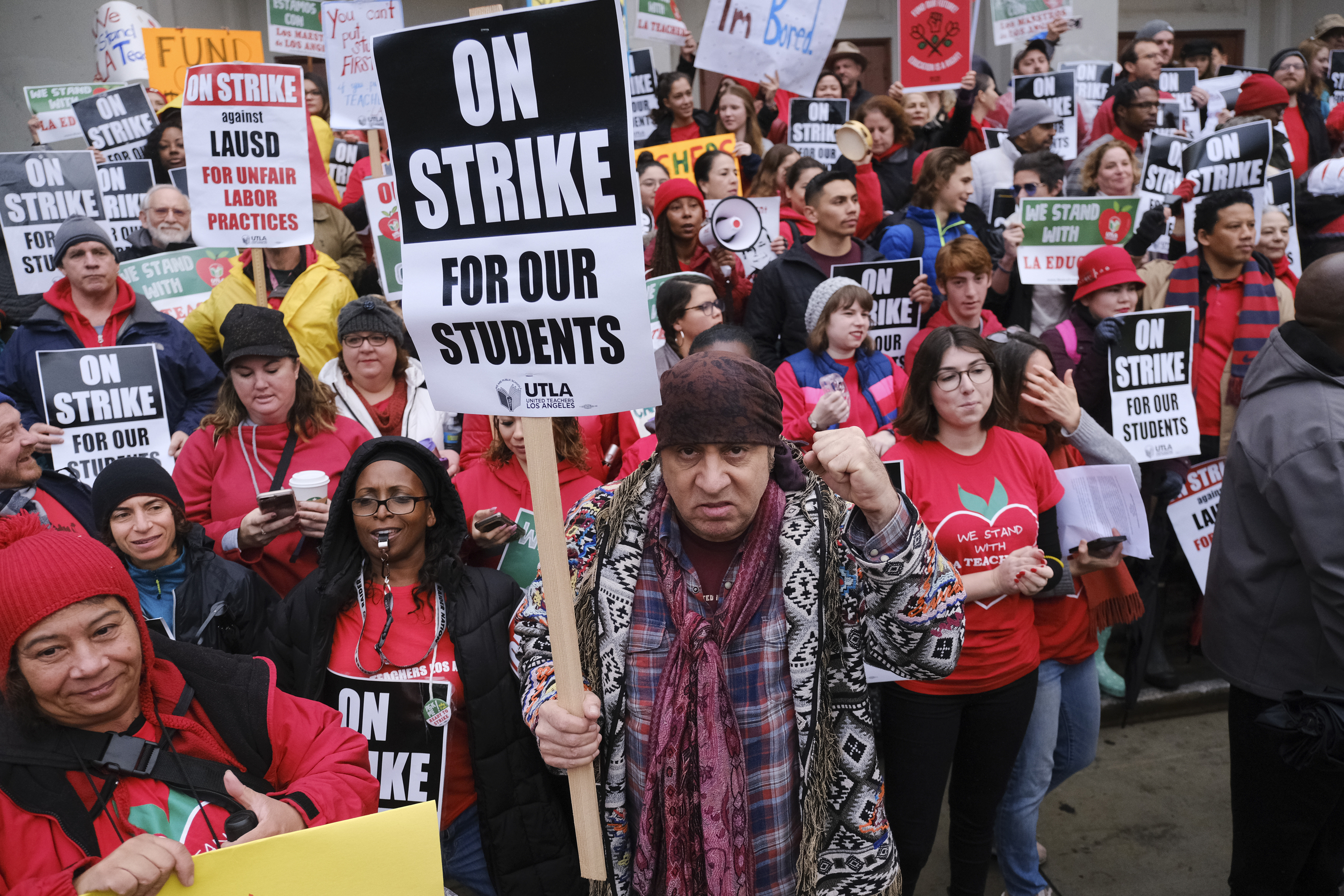 Actor, musician and activist, Steven Van Zandt, center, supports striking teachers on the picket in front of Hamilton High School in Los Angeles on Wednesday, Jan. 16, 2019. School administrators urged the union to resume bargaining as tens of thousands of teachers planned to walk picket lines for a third day Wednesday. (AP Photo/Richard Vogel)