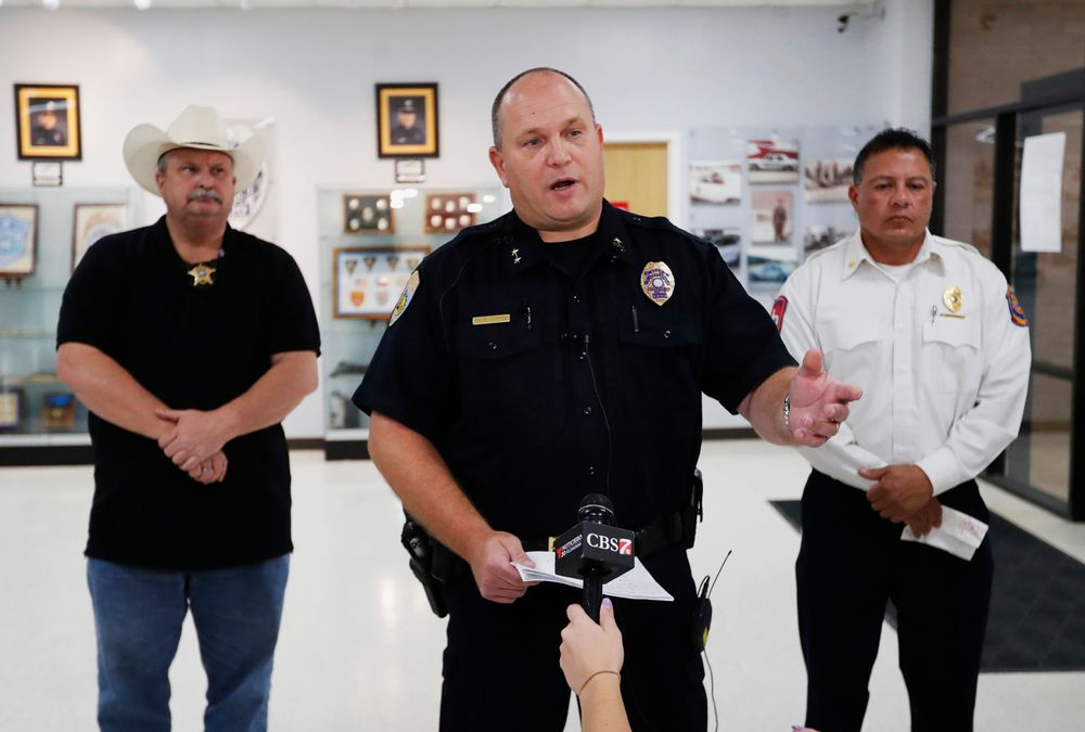 Odessa Police Chief Michael Gerke talks to the media in the Odessa Police Department in Odessa, Texas, Saturday, Aug. 31, 2019, after a man fired at random in the area of Odessa and Midland. Several people were dead after a gunman who hijacked a postal service vehicle in West Texas shot more than 20 people, authorities said Saturday. The gunman was killed and a few law enforcement officers were among the injured. (Mark Rogers/Odessa American via AP)