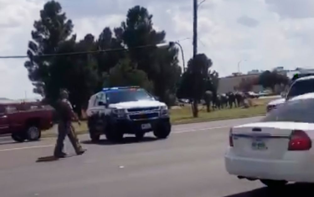 In this image made from video provided by Dustin Fawcett, police officers guard on a street in Odessa, Texas, Saturday, Aug. 31, 2019. Police said there are