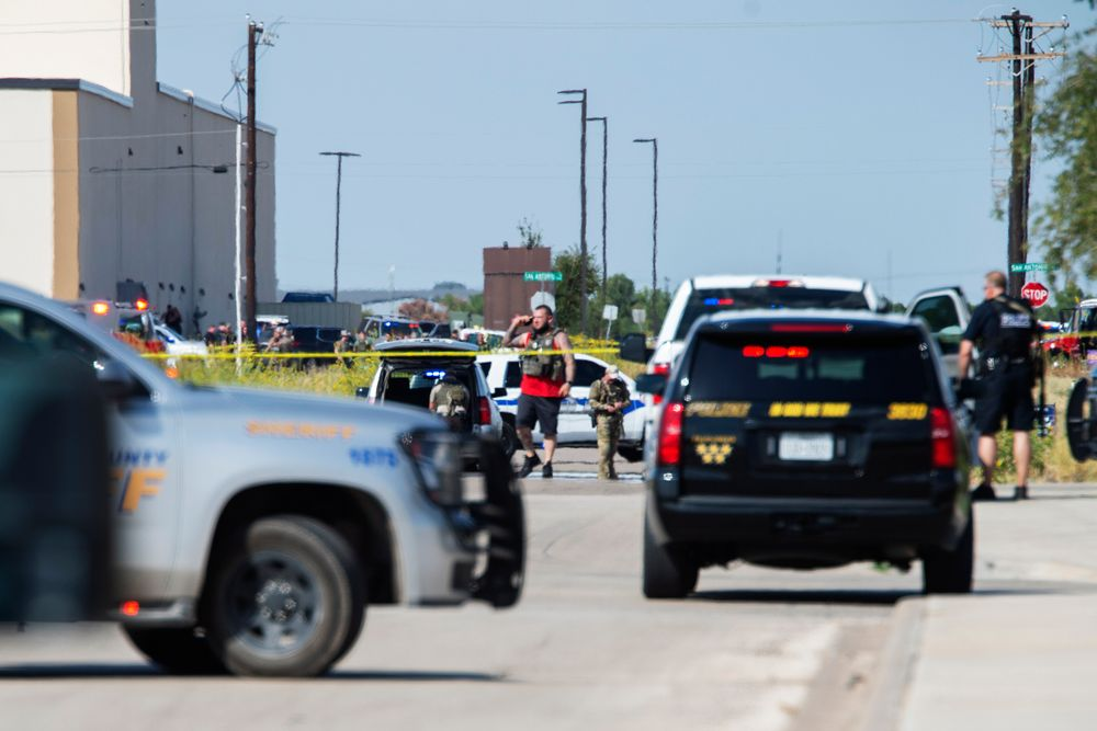 CORRECTS THE NAME OF THE SOURCE TO THE MIDLAND REPORTER-TELEGRAM - Odessa and Midland police and sheriff's deputies surround the area behind Cinergy in Odessa, Texas, Saturday, Aug. 31, 2019, after reports of shootings. Police said there are
