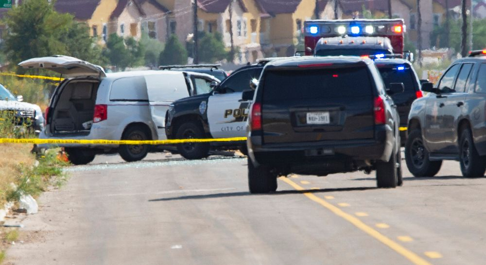 CORRECTS THE NAME OF THE SOURCE TO THE MIDLAND REPORTER-TELEGRAM - Odessa and Midland police and sheriff's deputies surround a white van in Odessa, Texas, Saturday, Aug. 31, 2019, after reports of gunfire. Police said there are