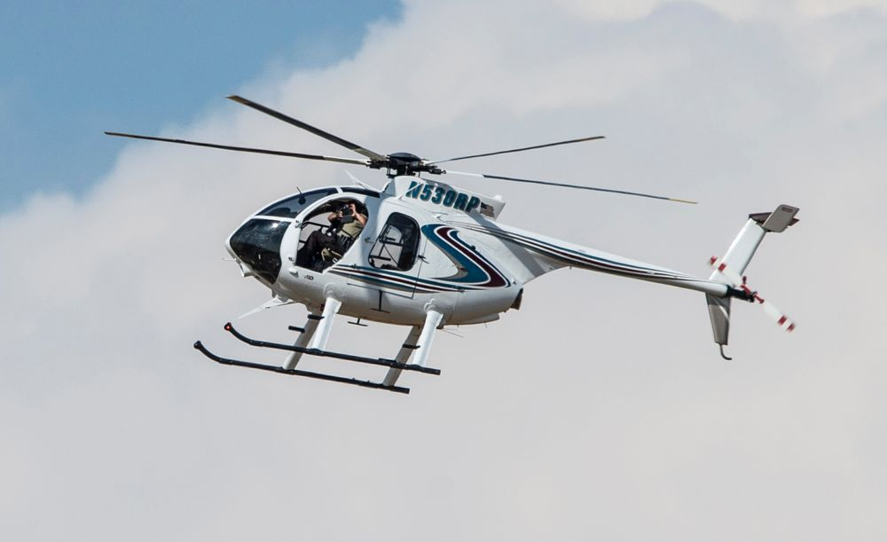 An authorities chopper flies over an area in Odessa, Texas, Saturday, Aug. 31, 2019, after reports of gunfire. Police said there are