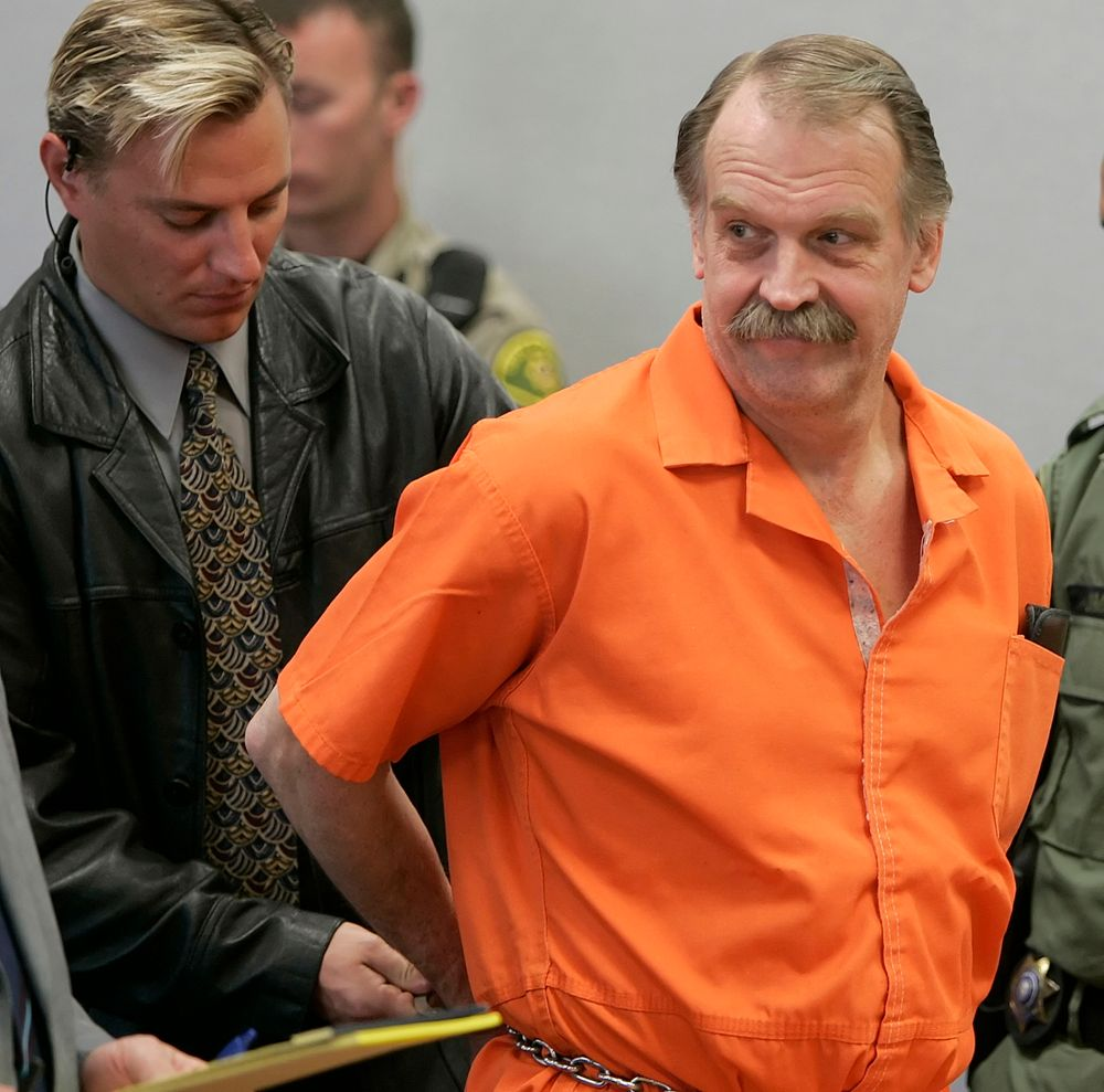 FILE - In this Oct. 6, 2005 file photo, convicted murderer and death row inmate Ron Lafferty is handcuffed after his court hearing in a courtroom in Provo, Utah. Utah prison officials said Monday, Nov. 11, 2019, that Lafferty, a death-row inmate whose double-murder case was featured in the book