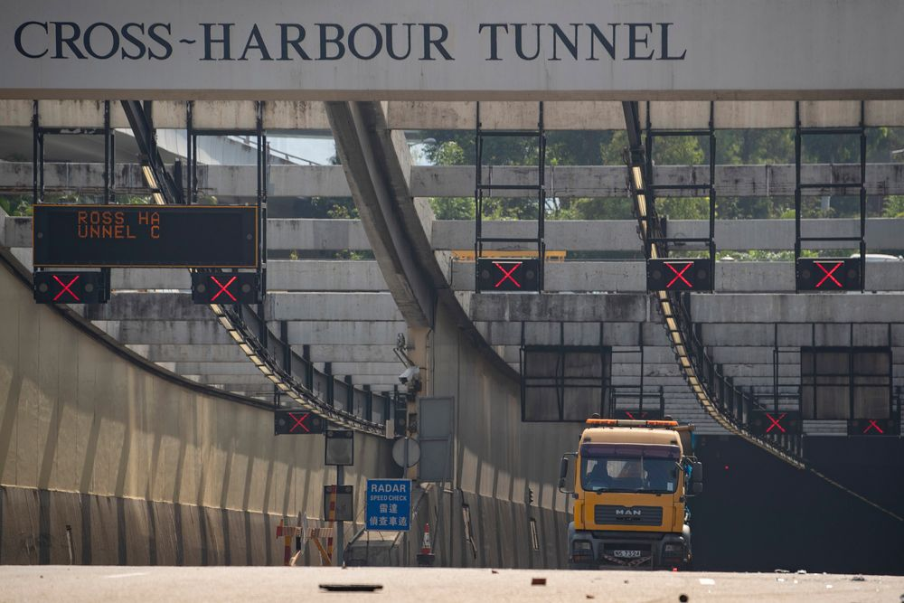 A truck is parked at the entrance to the Cross-Harbor Tunnel as clean up operations begin outside the Hong Kong Polytechnic University in Hong Kong on Wednesday, Nov. 20, 2019. Hong Kong schools have reopened after a six-day shutdown but students were facing transit disruptions as the last protesters remained holed up on a university campus. (AP Photo/Ng Han Guan)