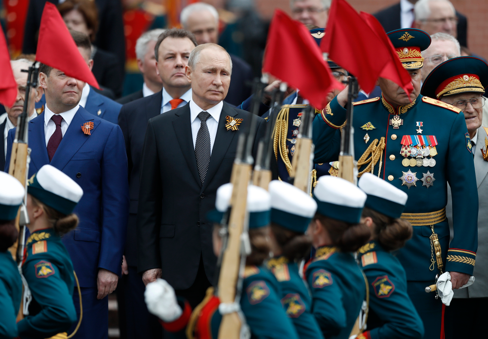 Russian President Vladimir Putin, centre, Russian Prime Minister Dmitry Medvedev, left, and Russian Defense Minister Sergei Shoigu, right, attend a wreath-laying ceremony at the Tomb of the Unknown Soldier after the military parade marking 74 years since the victory in WWII in Moscow, Russia, Thursday, May 9, 2019. (AP Photo/Pavel Golovkin)
