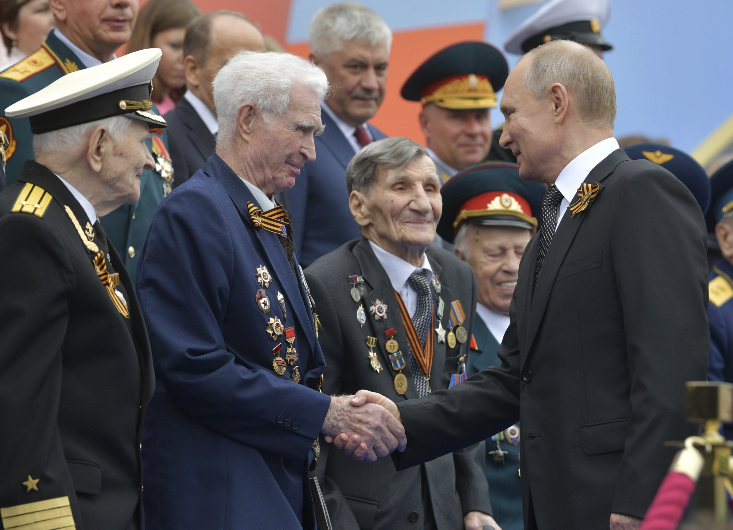 Russian President Vladimir Putin shakes hands with WWII veterans prior to a military parade marking 74 years since the victory in WWII in Red Square in Moscow, Russia, Thursday, May 9, 2019. (Alexei Druzhinin, Sputnik, Kremlin Pool Photo via AP)