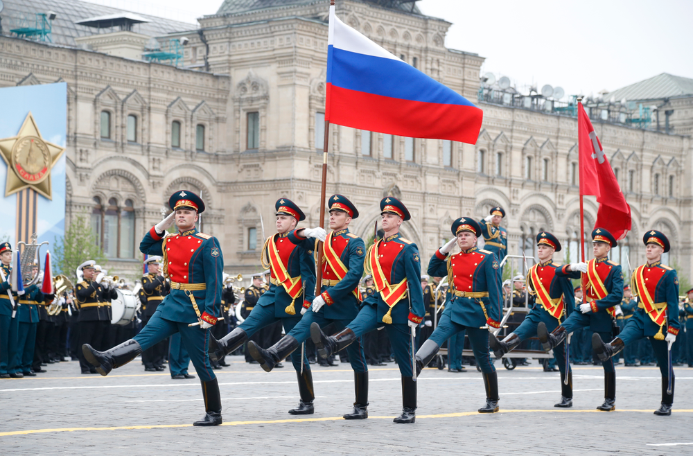 Russian honour guard carry a national flag, left, and a replica of the Victory banner during the military parade to celebrate 74 years since the victory in WWII in Red Square in Moscow, Russia, Thursday, May 9, 2019. (AP Photo/Alexander Zemlianichenko)