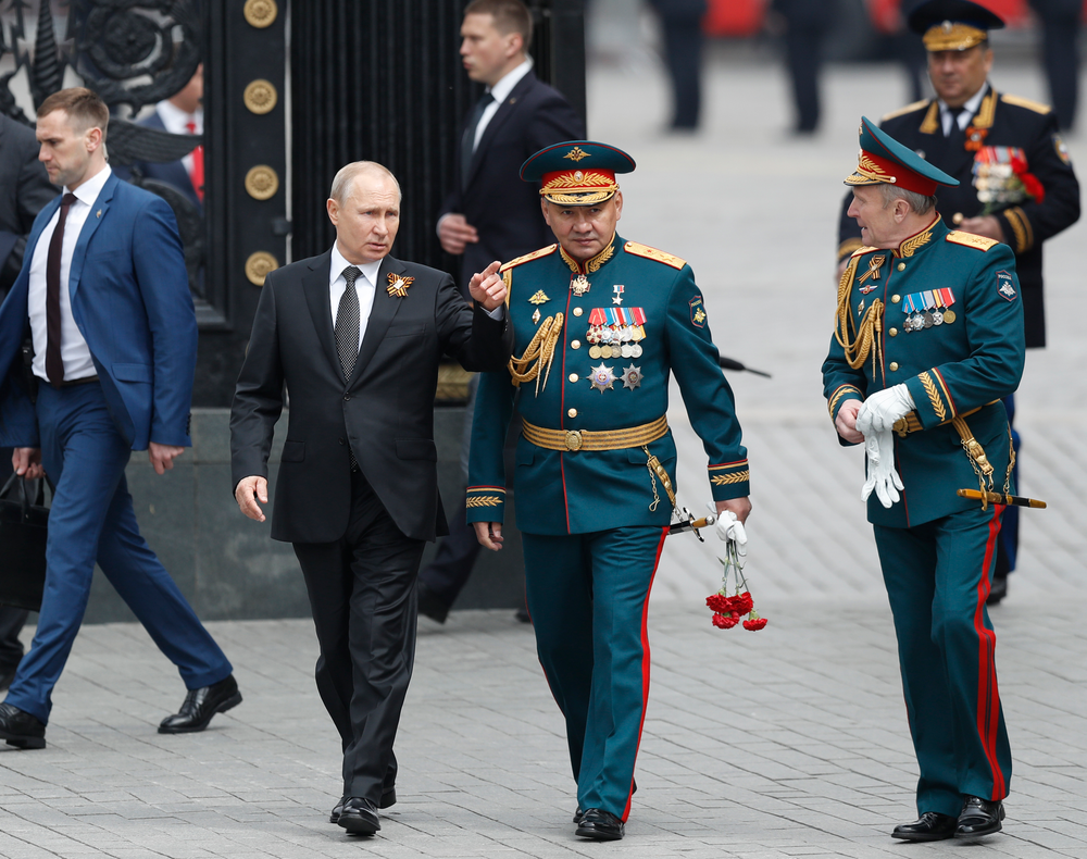 Russian President Vladimir Putin, centre left, Russian Defense Minister Sergei Shoigu, center, and Commander-in-Chief of the Graund Forces and Victory Parade Commander Colonel-General Oleg Salyukov, right, walk to attend a wreath-laying ceremony at the Tomb of the Unknown Soldier after the military parade marking 74 years since the victory in WWII in Moscow, Russia, Thursday, May 9, 2019. (AP Photo/Pavel Golovkin)