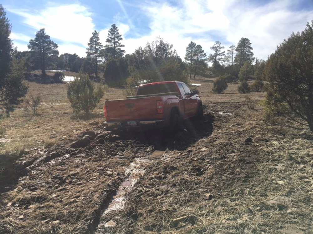 This March 2019 photo provided by the Coconino County Sheriff's Office shows a vehicle belonging to Ryan Long near Happy Jack, Ariz. Long, 38, who likely died from exposure while stranded in Arizona might have survived if he had not rejected rescue efforts because he was afraid of being arrested, authorities said Tuesday, March 19, 2019. (Coconino County Sheriff's Office via AP)