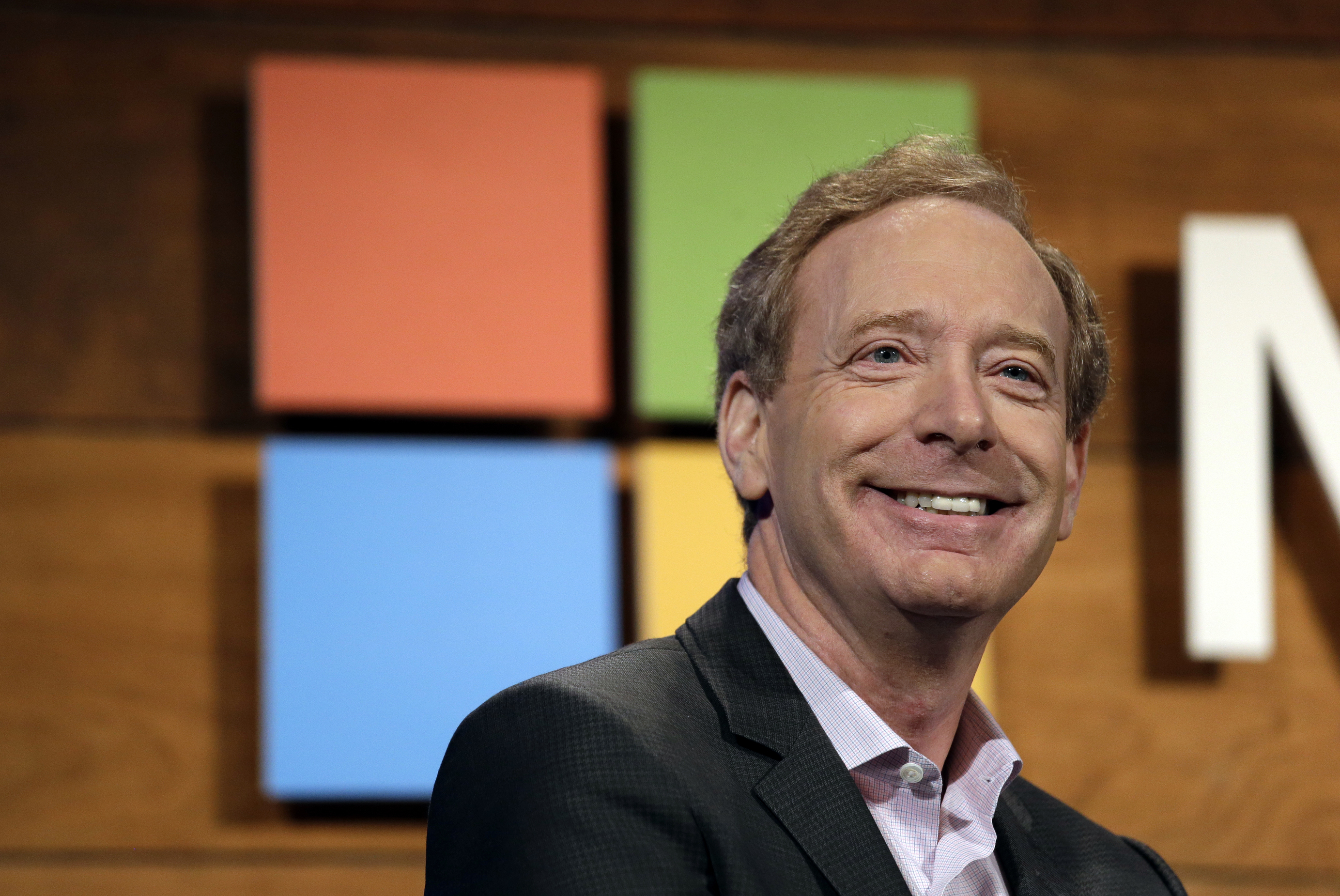 FILE - In this Nov. 30, 2016 file photo, Microsoft's Brad Smith, president and chief legal officer, speaks at the annual Microsoft shareholders meeting in Bellevue, Wash. Microsoft has pledged $500 million to address homelessness and develop affordable housing in response to the Seattle region's widening affordability gap. Most of the money will be aimed at increasing housing options in the Puget Sound region for low- and middle-income workers at a time when they're being priced out of Seattle and some of its suburbs, and when the vast majority of new buildings target wealthier renters, said Smith. (AP Photo/Elaine Thompson, File)