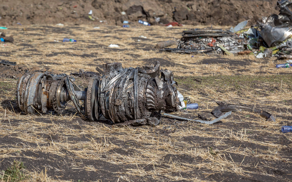 FILE- In this March 11, 2019, file photo airplane parts lie on the ground at the scene of an Ethiopian Airlines flight crash near Bishoftu, or Debre Zeit, south of Addis Ababa, Ethiopia. Investigators have determined that an anti-stall system automatically activated before the Ethiopian Airlines Boeing 737 Max jet plunged into the ground, The Wall Street Journal reported Friday, March 29. (AP Photo/Mulugeta Ayene, File)