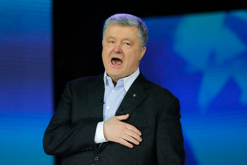 Ukrainian President Petro Poroshenko sings the national anthem after debates between two candidates in the weekend presidential run-off at the Olympic stadium in Kiev, Ukraine, Friday, April 19, 2019. Friday is the last official day of election canvassing in Ukraine as all presidential candidates and their campaigns will be barred from campaigning on Saturday, the day before the vote. (AP Photo/Vadim Ghirda)