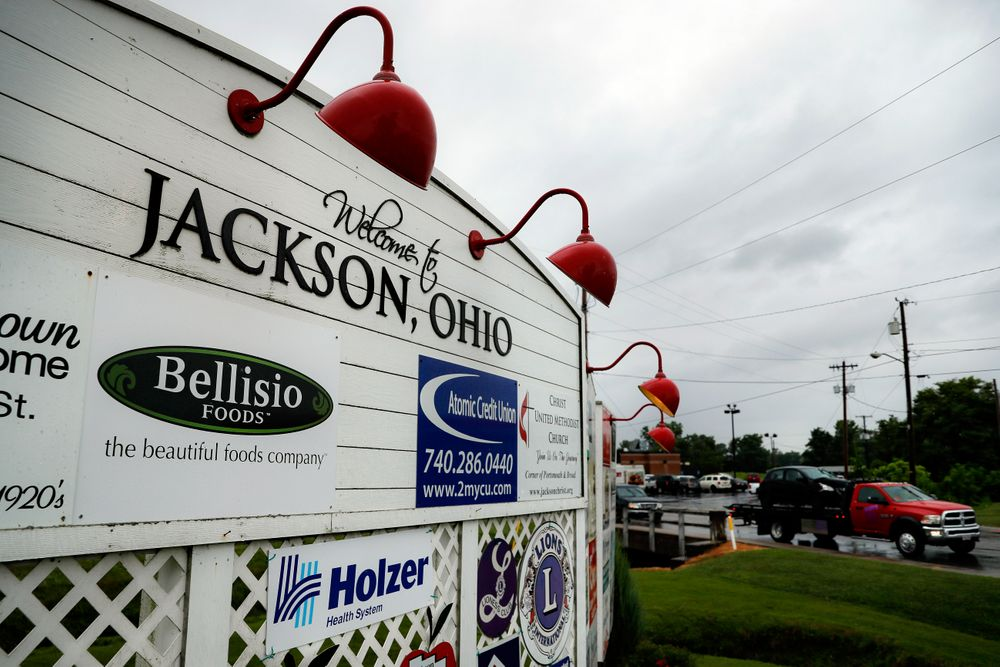 Traffic passes along a main thoroughfare as rain clouds gather overhead, Wednesday, July 17, 2019, in Jackson, Ohio. Newly released prescription opioid statistics underscore how widespread pill use has been in towns and small cities of America's Appalachian region. In Jackson County, an average yearly total of 107 opioid pills for every resident were distributed over a seven-year period. (AP Photo/John Minchillo)
