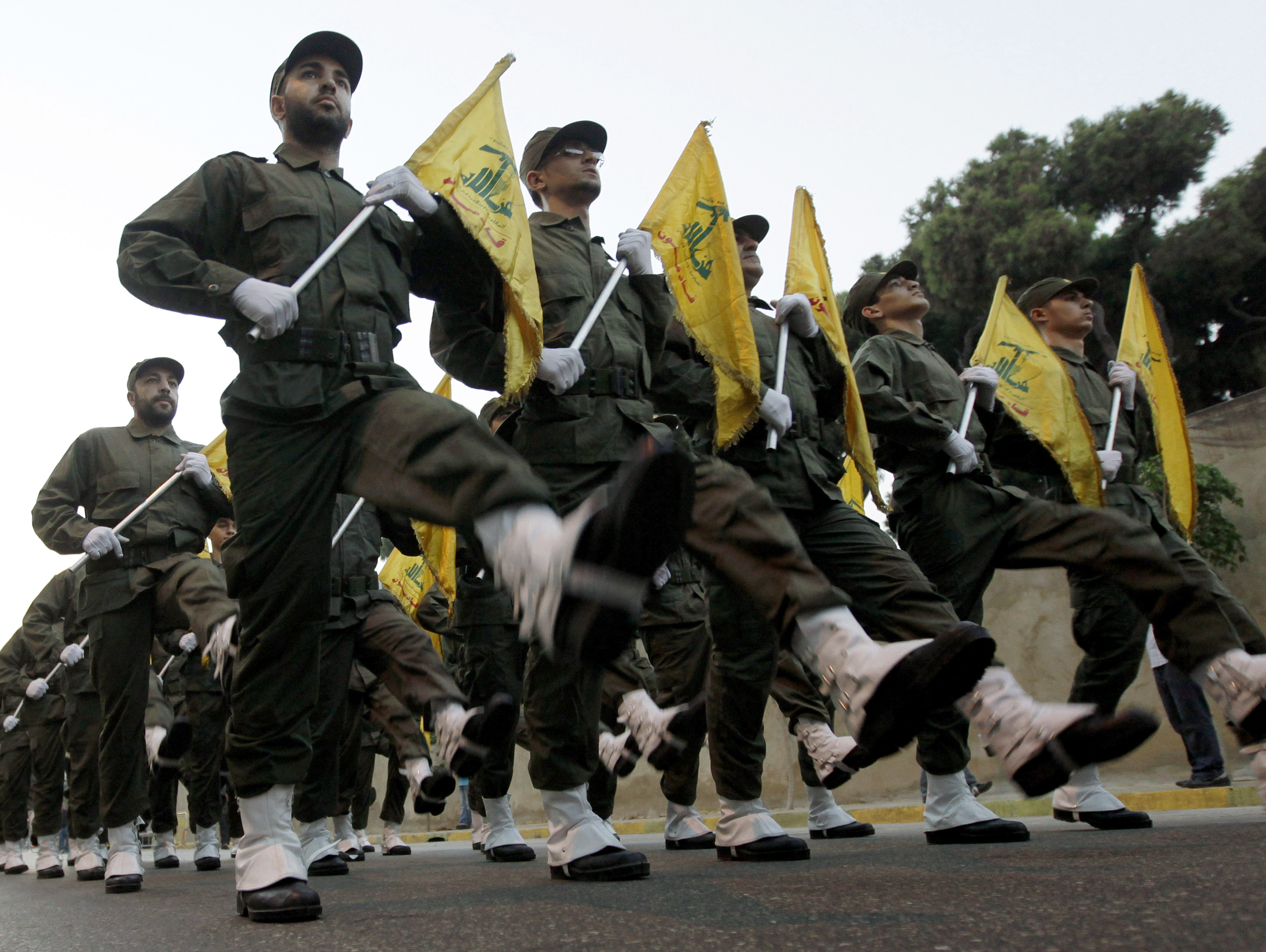 FILE - In this Nov. 12, 2010 file photo, Hezbollah fighters parade during the inauguration of a new cemetery for their fighters who died in fighting against Israel, in a southern suburb of Beirut, Lebanon. The British government will make inciting support for Hezbollah a criminal offense as senior officials accused the Iran-backed organization of destabilizing the Middle East. (AP Photo/Hussein Malla, File)