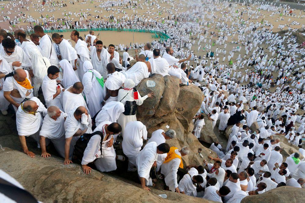 Muslim pilgrims make their way down on a rocky hill known as Mountain of Mercy, on the Plain of Arafat, during the annual hajj pilgrimage, near the holy city of Mecca, Saudi Arabia, Saturday, Aug. 10, 2019. More than 2 million pilgrims were gathered to perform initial rites of the hajj, an Islamic pilgrimage that takes the faithful along a path traversed by the Prophet Muhammad some 1,400 years ago. (AP Photo/Amr Nabil)
