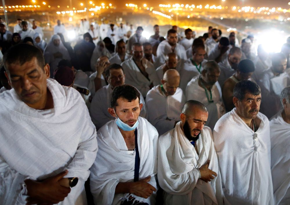 Muslim pilgrims offer dawn prayers on a rocky hill known as Mountain of Mercy, on the Plain of Arafat, during the annual hajj pilgrimage, ahead of sunrise near the holy city of Mecca, Saudi Arabia, Saturday, Aug. 10, 2019. More than 2 million pilgrims were gathered to perform initial rites of the hajj, an Islamic pilgrimage that takes the faithful along a path traversed by the Prophet Muhammad some 1,400 years ago. (AP Photo/Amr Nabil)