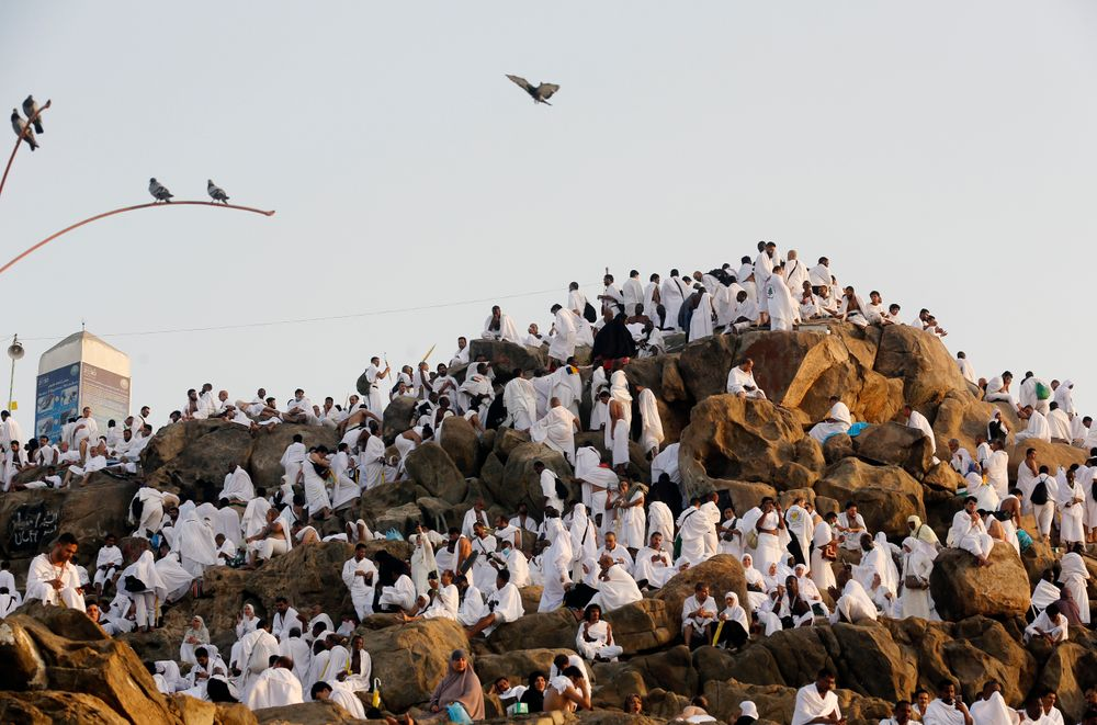 Muslim pilgrims pray on a rocky hill known as Mountain of Mercy, on the Plain of Arafat, during the annual hajj pilgrimage, near the holy city of Mecca, Saudi Arabia, Saturday, Aug. 10, 2019. More than 2 million pilgrims were gathered to perform initial rites of the hajj, an Islamic pilgrimage that takes the faithful along a path traversed by the Prophet Muhammad some 1,400 years ago. (AP Photo/Amr Nabil)