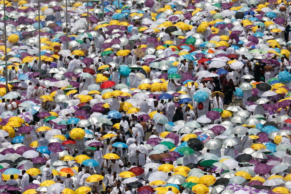 Hundreds of thousands of Muslim pilgrims listen to a sermon outside Namira Mosque in Arafat during the annual hajj pilgrimage, near the holy city of Mecca, Saudi Arabia, Saturday, Aug. 10, 2019. More than 2 million pilgrims were gathered to perform initial rites of the hajj, an Islamic pilgrimage that takes the faithful along a path traversed by the Prophet Muhammad some 1,400 years ago. (AP Photo/Amr Nabil)