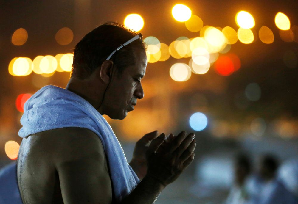 A Muslim pilgrim prays on a rocky hill known as Mountain of Mercy, on the Plain of Arafat, during the annual hajj pilgrimage, near the holy city of Mecca, Saudi Arabia, Saturday, Aug. 10, 2019. More than 2 million pilgrims were gathered to perform initial rites of the hajj, an Islamic pilgrimage that takes the faithful along a path traversed by the Prophet Muhammad some 1,400 years ago. (AP Photo/Amr Nabil)