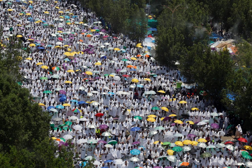 Hundreds of thousands of Muslim pilgrims pray outside Namira Mosque in Arafat during the annual hajj pilgrimage, near the holy city of Mecca, Saudi Arabia, Saturday, Aug. 10, 2019. More than 2 million pilgrims were gathered to perform initial rites of the hajj, an Islamic pilgrimage that takes the faithful along a path traversed by the Prophet Muhammad some 1,400 years ago. (AP Photo/Amr Nabil)