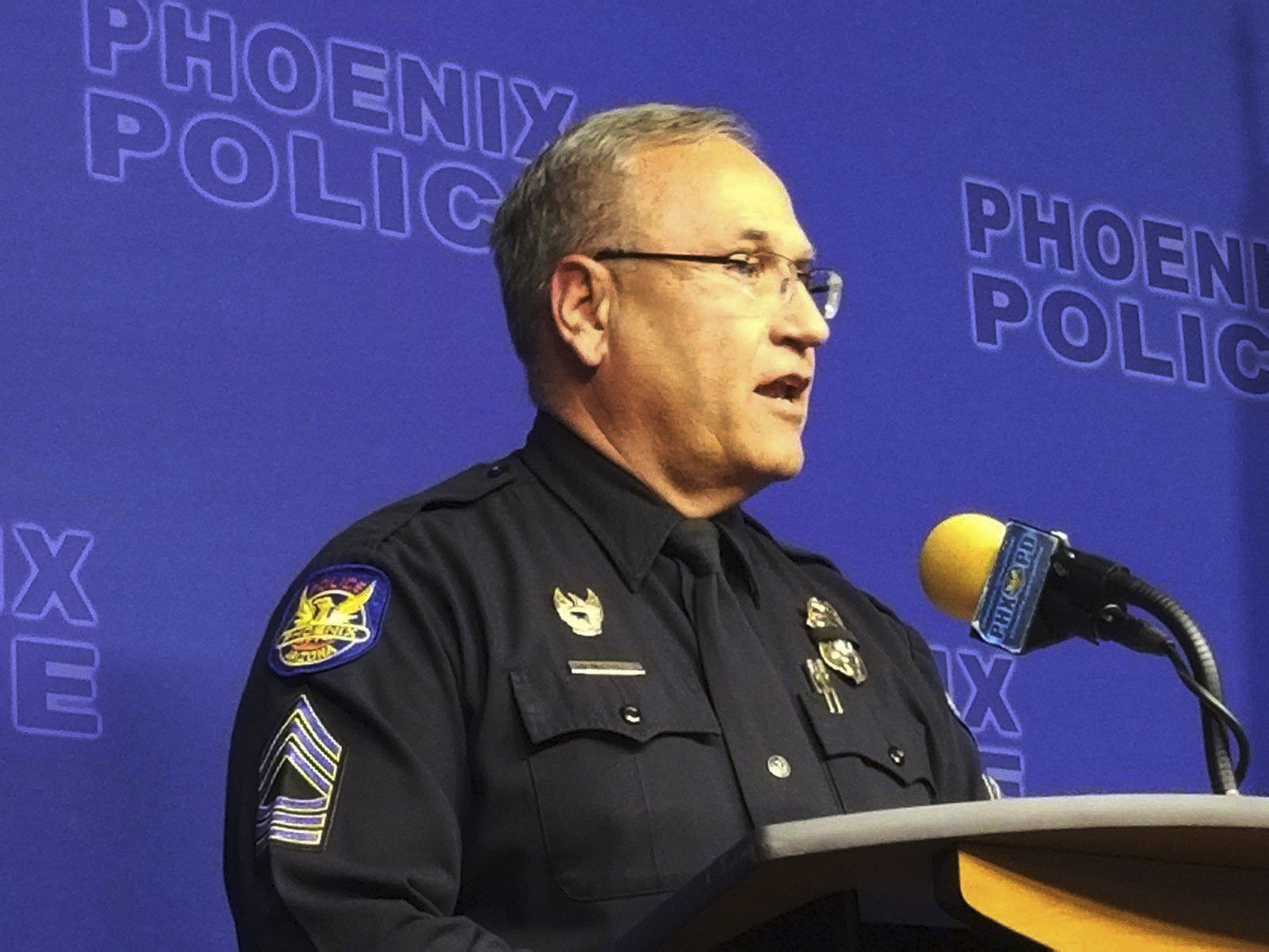 Phoenix Police spokesman Tommy Thompson speaks at a news conference, Wednesday, Jan. 9, 2019, in Phoenix, about the investigation of a woman at a long-term care facility who gave birth. The Phoenix woman, who is in a vegetative state and was sexually assaulted at the facility and had a baby, is recovering at a hospital along with her child, authorities said. (AP Photo/Terry Tang)