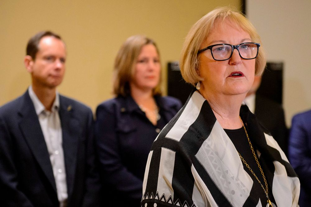 Former Utah Supreme Court Justice Christine Durham speaks at a news conference announcing her addition to the legal team representing Matt and Jill McCluskey, left, in their case against the University of Utah in Salt Lake City on Monday, Nov. 25, 2019. The parents of Lauren McCluskey, a University of Utah student and track athlete who was fatally shot on campus, are fighting a claim by the college that their lawsuit should be dismissed because their daughter's killer wasn't a student. (Trent Nelson/The Salt Lake Tribune via AP)