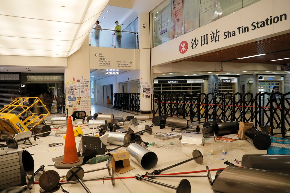 Protesters block the entrance to a subway station with debris Sunday, Sept. 22, 2019, in Hong Kong. Protesters smashed surveillance cameras and electronic ticket sensors in the subway station, as pro-democracy demonstrations took a violent turn once again. (AP Photo/Kin Cheung)