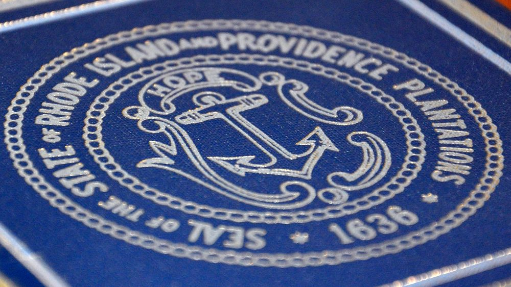 The Rhode Island state seal on the cover of an encyclopedia is pictured here.