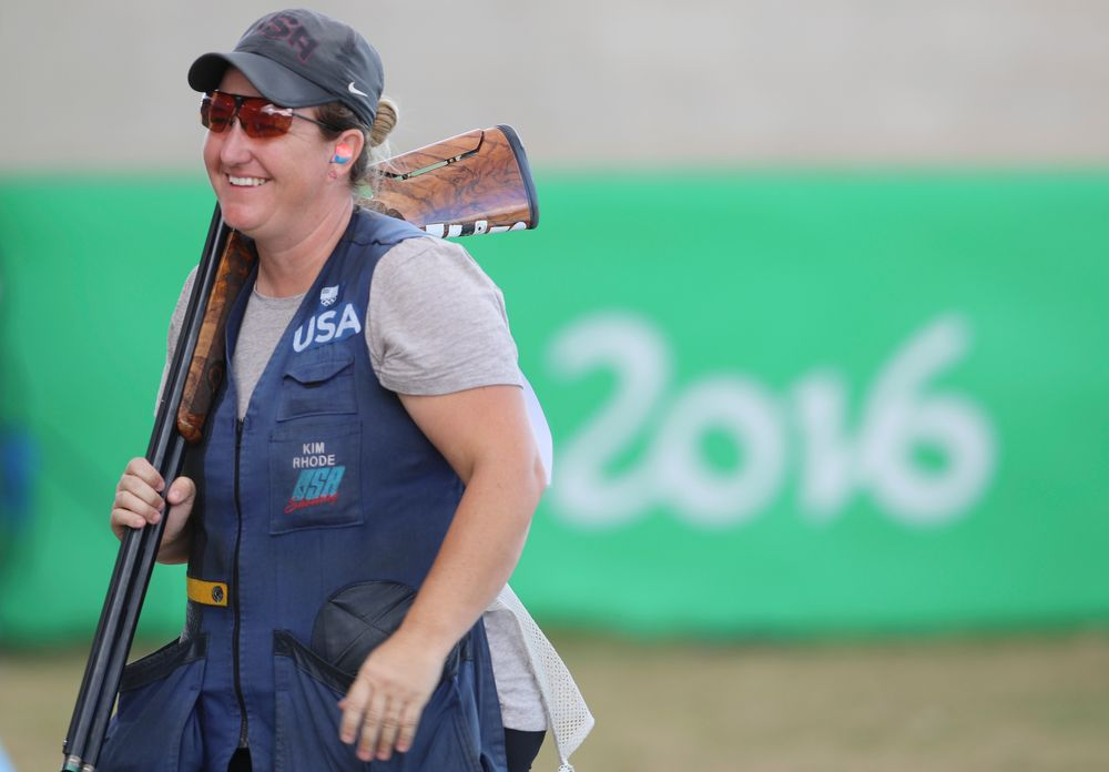 FILE -- In this Aug. 12, 2016 file photo Kimberly Rhode of the United States smiles after she won the bronze medal match of the women's skeet event at Olympic Shooting Center at the 2016 Summer Olympics in Rio de Janeiro, Brazil. Rhode, who has medaled in six straight Olympic Games, is the star plaintiff in a lawsuit to stop a 2016 voter-approved ballot initiative requiring background checks for the purchase of ammunition that is to take effect July 1. (AP Photo/Eugene Hoshiko, File)